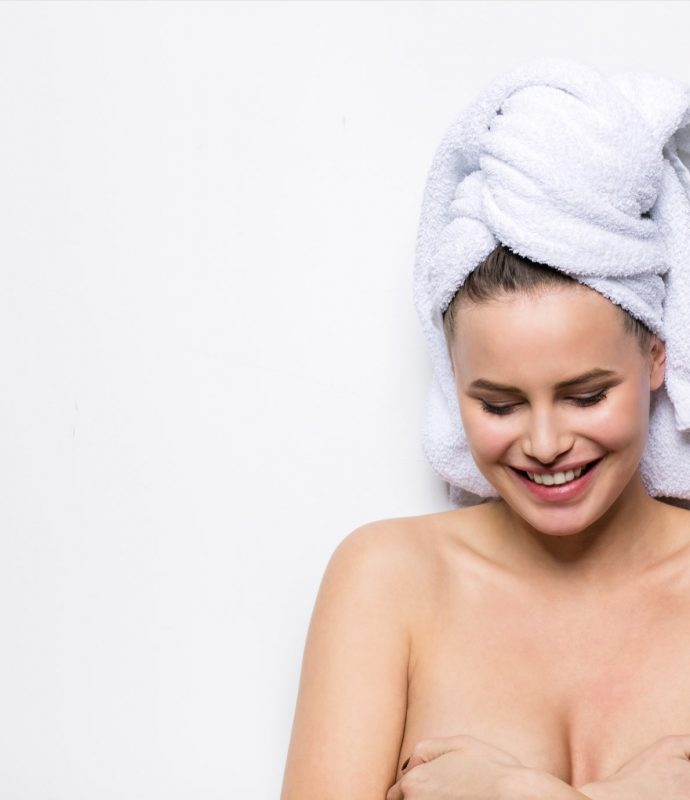 Naked woman with towel on her head