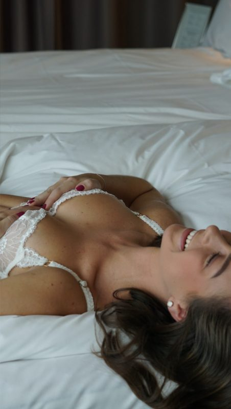 Smiling woman laying on a bed
